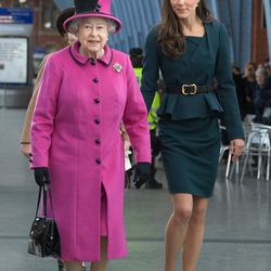 Strolling with the Queen of England on March 8th, 2012 in an L.K. Bennett dress.