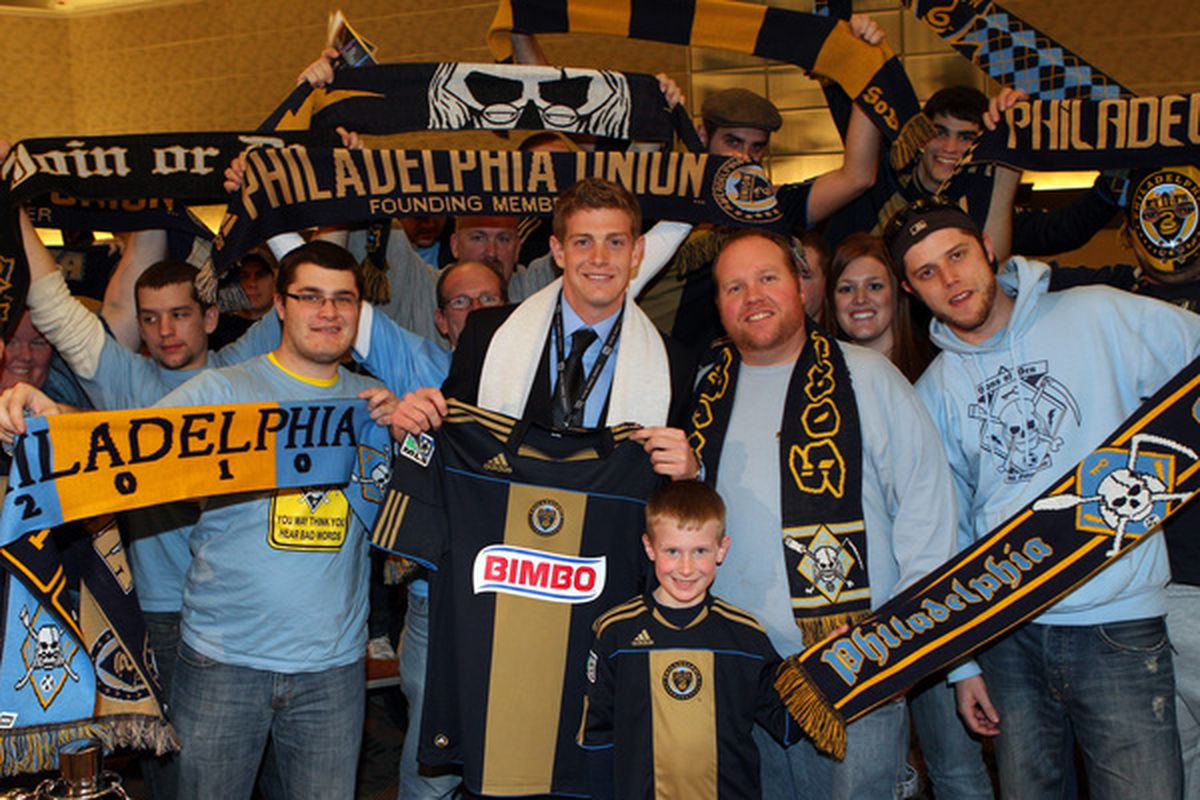 BALTIMORE - JANUARY 13: Fifth selection Zac MacMath of the Philadelphia Union poses for a photo with fans during the 2011 MLS SuperDraft on January 13 2011 at the Baltimore Convention Center in Baltimore Maryland. (Photo by Ned Dishman/Getty Images)
