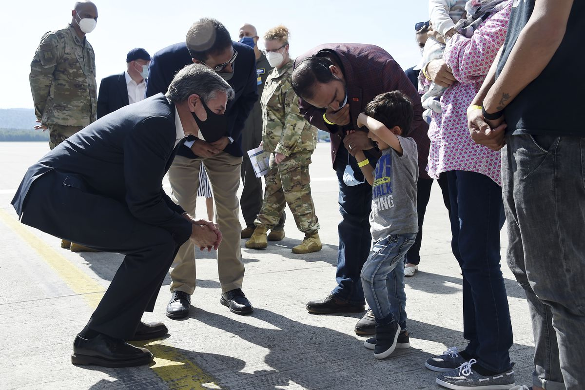 The U.S. secretary of state meets with a refugee family in Afghanistan.