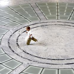 A small child runs on the floor of the Capitol Rotunda as the Legislature 2009 session of the Utah Legislature gets underway at the Capitol building in Salt Lake City, Monday.