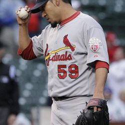 St. Louis Cardinals relief pitcher Fernando Salas adjusts his cap after Chicago Cubs' Darwin Barney hit a two-run home run during the ninth inning of a baseball game in Chicago, Friday, Sept. 21, 2012. The Cubs won 5-4 in 11 innings.
