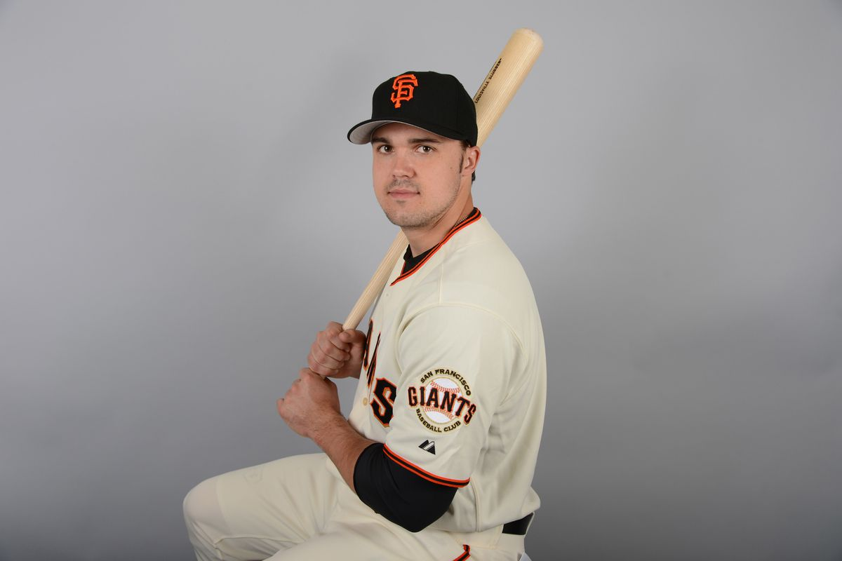This is Adam Duvall sitting on a stool, holding a bat