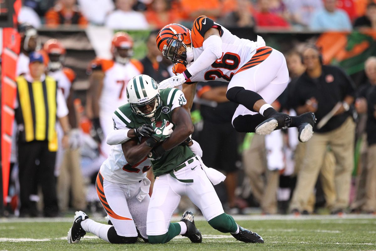 Aug 10, 2012; Cincinnati, OH, USA; New York Jets receiver Stephan Hill (84) is hit up high after a catch by Cincinnati Bengals cornerback Taylor Mays (26) at Paul Brown Stadium.  Mandatory Credit: Matthew Emmons-US PRESSWIRE