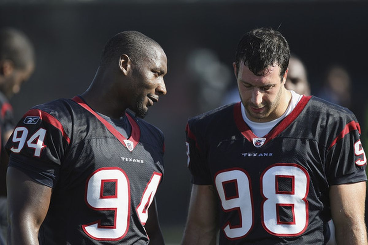 HOUSTON - JULY 30:  Defensive ends Antonion Smith #98 and Connor Barwin #98 talk during the team's first NFL training camp practice of the season at Reliant Park on July 30 2010 in Houston Texas.  (Photo by Bob Levey/Getty Images)