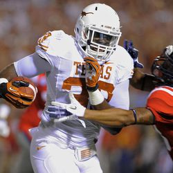Texas linebacker Steve Edmond (33) runs back an interception of a Mississippi pass during the first quarter of an NCAA college football game in Oxford, Miss., Saturday, Sept. 15, 2012.