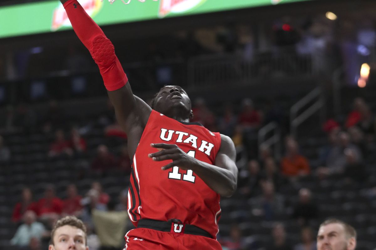 Utah Utes guard Both Gach gets to the basket for a score.