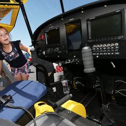 Trinelle Hardinger gets a look inside an airplane as she and her family attends the Skypark Aviation Festival and Expo at Skypark Airport in Woods Cross on Friday, June 2, 2017. The expo is Utah's largest annual aviation event.