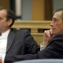 Gordon Moon, right, is pictured with his defense attorney, David Leavitt, during a preliminary hearing Thursday, Dec. 22, 2011, in 8th District Court. Moon, the bishop of the Church of Jesus Christ of Latter-day Saints ward in Duchesne, is charged with charged with witness tampering, a third-degree felony; and failure to report abuse, a class B misdemeanor.
