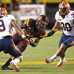 Arizona State wide receiver Jamal Miles works between Illinois defenders Houston Bates (30) and Earnest Thomas (9) during the first half of an NCAA college football game, Saturday, Sept. 8, 2012, in Tempe, Ariz.