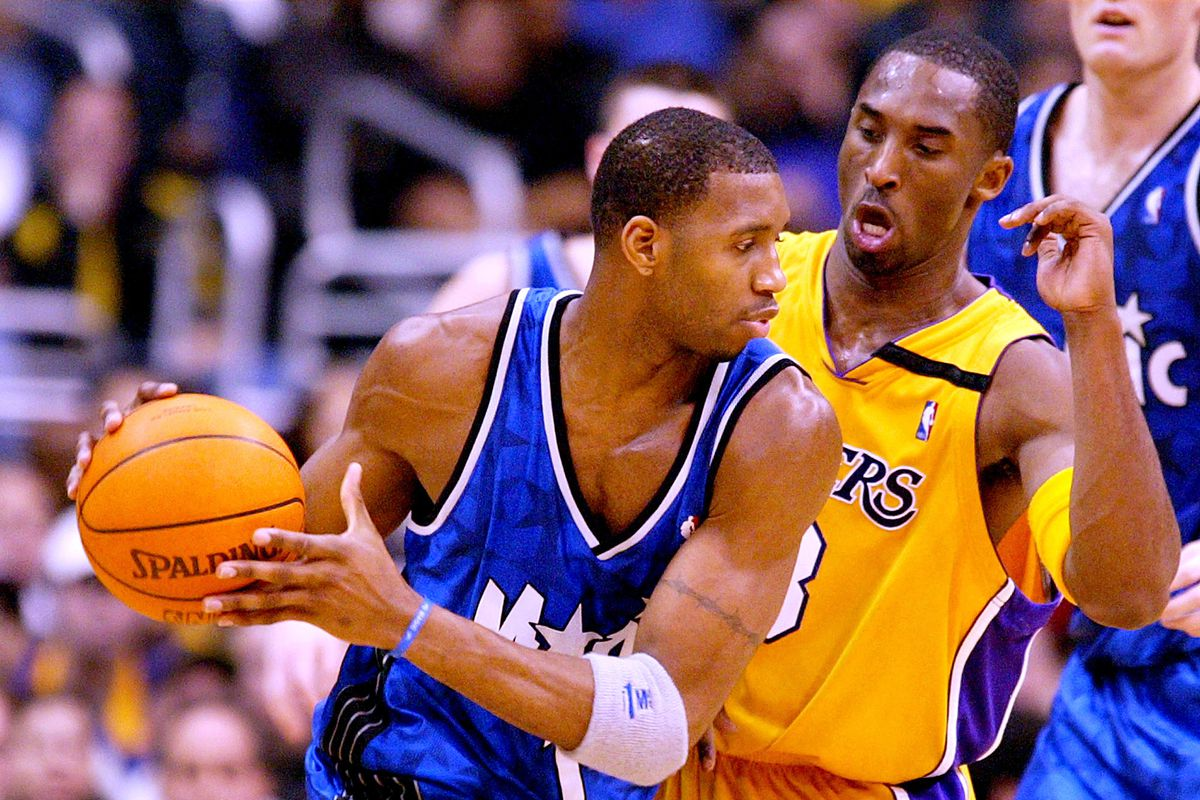 Lakers Kobe Bryant tries to defend the Orlando Magic's Tracy McGrady in the first half at the Staple