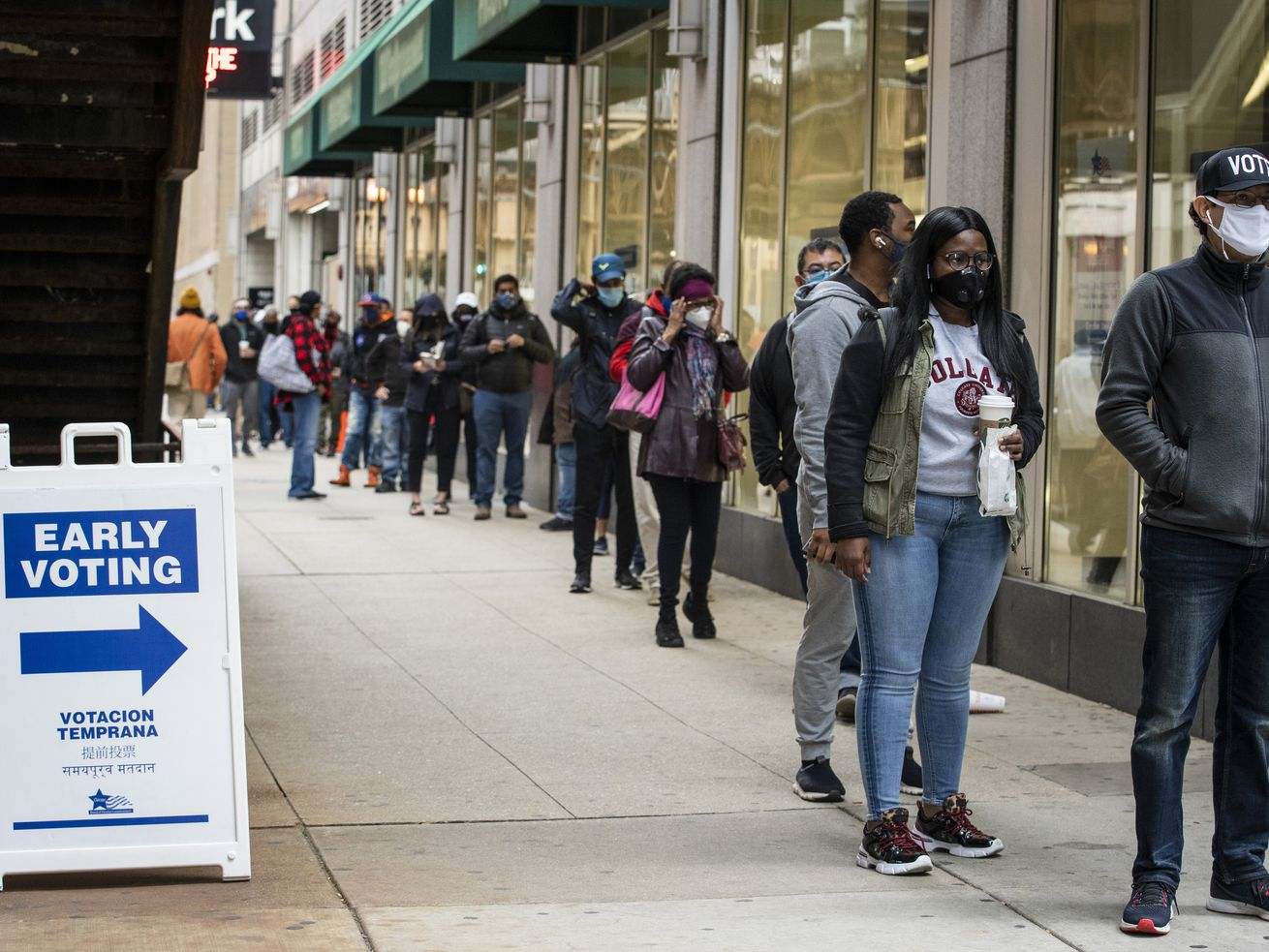 Hundreds of people wait in line to early vote at the Loop Super Site on Oct. 1, 2020.
