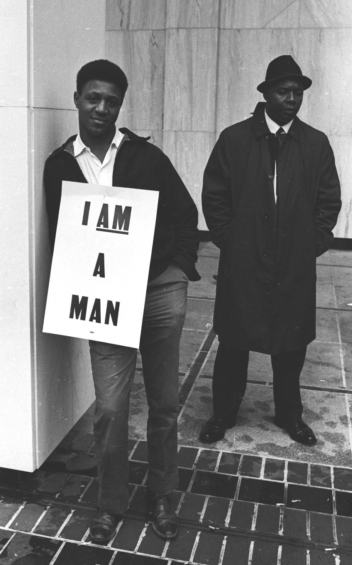 Two men during a march after the assassination of Martin Luther King in 1968.