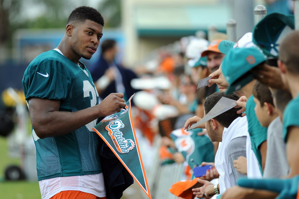 July 28 2012; Davie, FL, USA; Miami Dolphins running back Daniel Thomas (33) signs autographs after practice at the Dolphins training facility. Mandatory Credit: Steve Mitchell-US PRESSWIRE