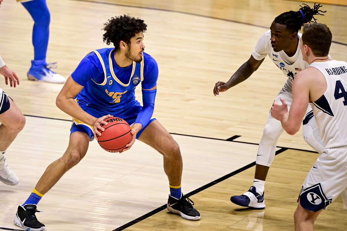 UCLA Bruins guard Johnny Juzang looks to pass the ball against the Brigham Young Cougars during the first round of the 2021 NCAA Tournament at Hinkle Fieldhouse.