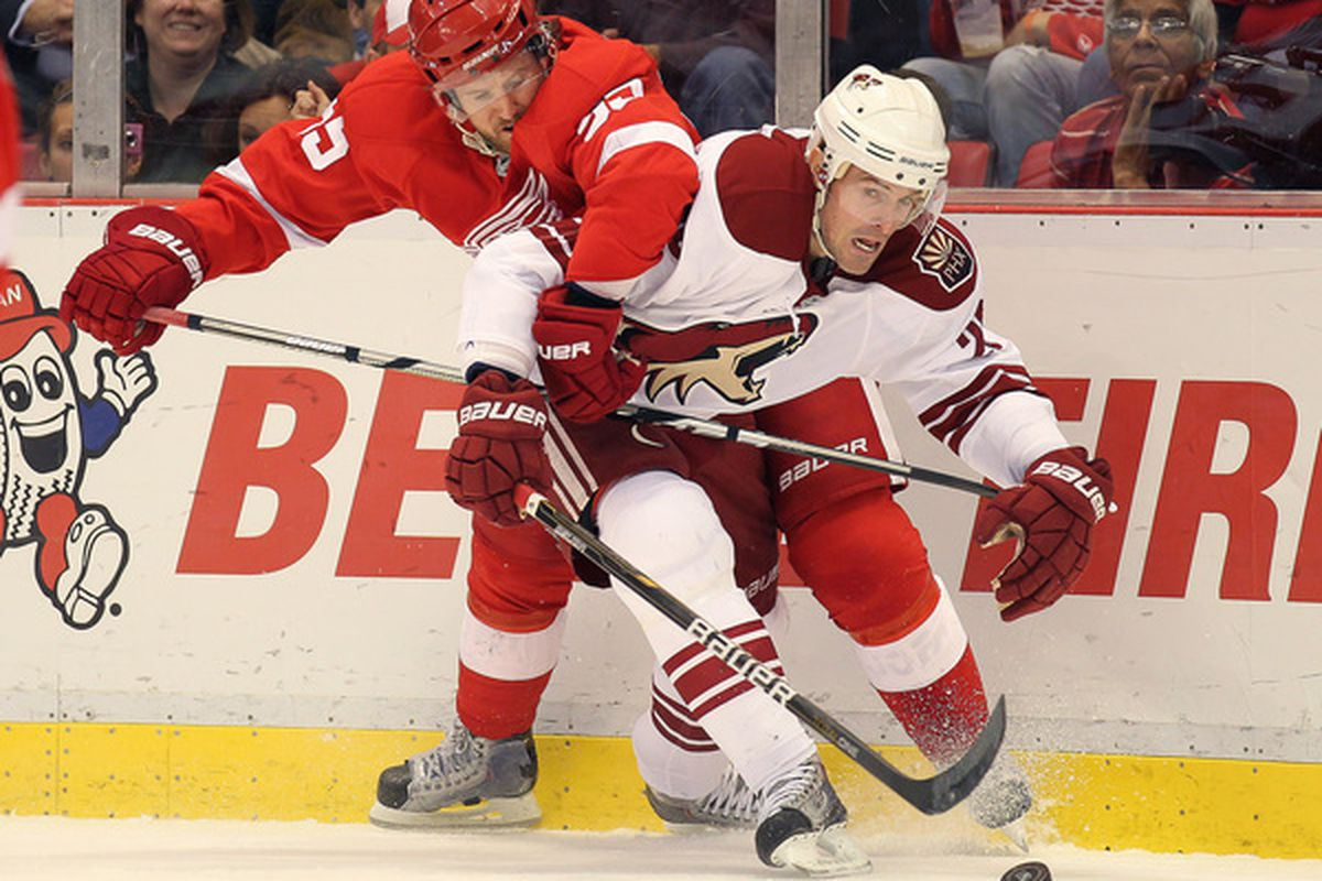 DETROIT MI - NOVEMBER 8:  Niklas Kronwall #55 of the Detroit Red Wings tries to hold up Eric Belanger #20 of the Phoenix Coyotes in a game on November 8,2010 at the Joe Louis Arena in Detroit Michigan. (Photo by Claus Andersen/Getty Images)