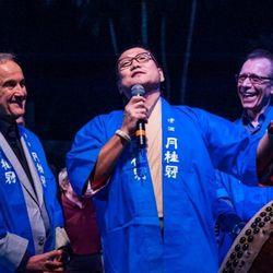 Chef Masaharu Morimoto sings while Larry Ruvo and Michael Severino look on at UNLV Sake Fever.