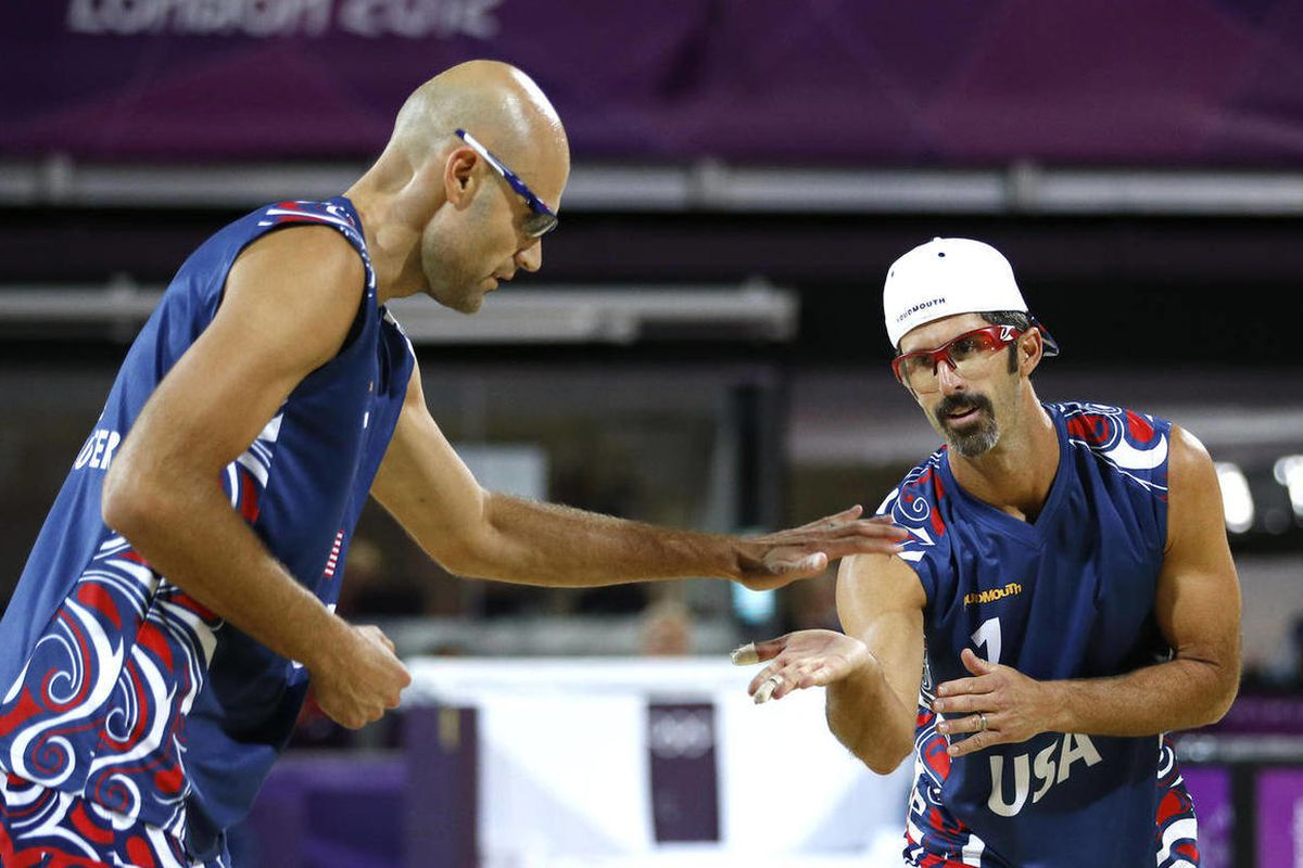 United States' Todd Rogers, right, and Phil Dalhausser react after making a shot against Czech Republic during a beach volleyball match at the 2012 Summer Olympics, London, Thursday, Aug. 2, 2012.