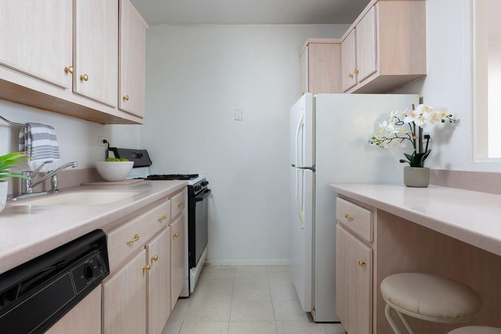 A narrow kitchen with two counters.