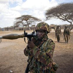 FILE - In this Monday, Feb. 20, 2012 file photo, a Kenyan army soldier carries a rocket-propelled grenade launcher as he patrols in Tabda, inside Somalia. Kenya's military said Friday, Sept. 28, 2012 that its troops attacked Kismayo, the last remaining port city held by al-Qaida-linked al-Shabab insurgents in Somalia, during an overnight attack involving a beach landing.