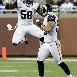St. Louis Rams linebacker Jo-Lonn Dunbar (58) celebrates with linebacker James Laurinaitis, right, after intercepting Detroit Lions quarterback Matthew Stafford and returning the ball for 42-yards in the second quarter of an NFL football game, Sunday, Sept. 9, 2012, in Detroit.
