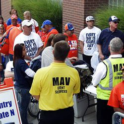 Fans line up before the Boise State vs Brigham Young University football game in Boise, Thursday, Sept. 20, 2012.