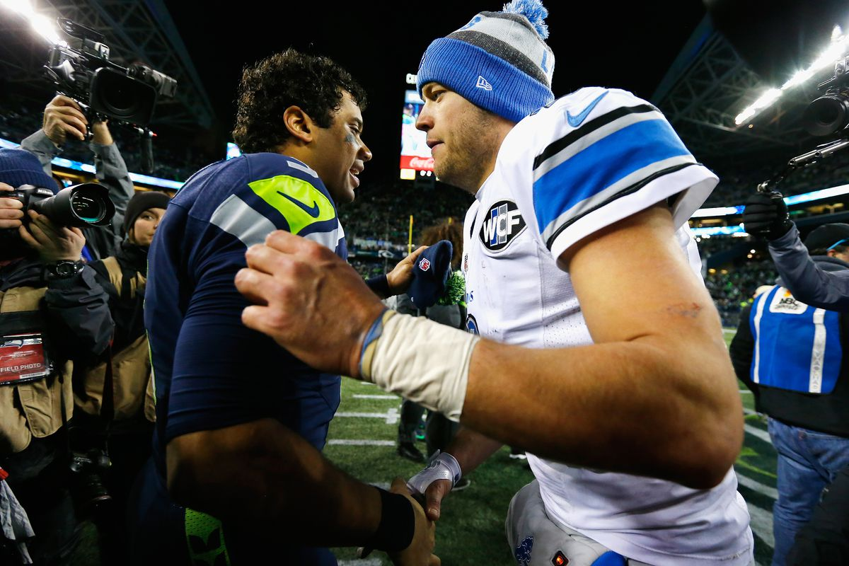 Russell Wilson #3 of the Seattle Seahawks greets Matthew Stafford #9 of the Detroit Lions after the Seahawks defeated the Lions 26-6 in the NFC Wild Card game at CenturyLink Field on January 7, 2017 in Seattle, Washington.