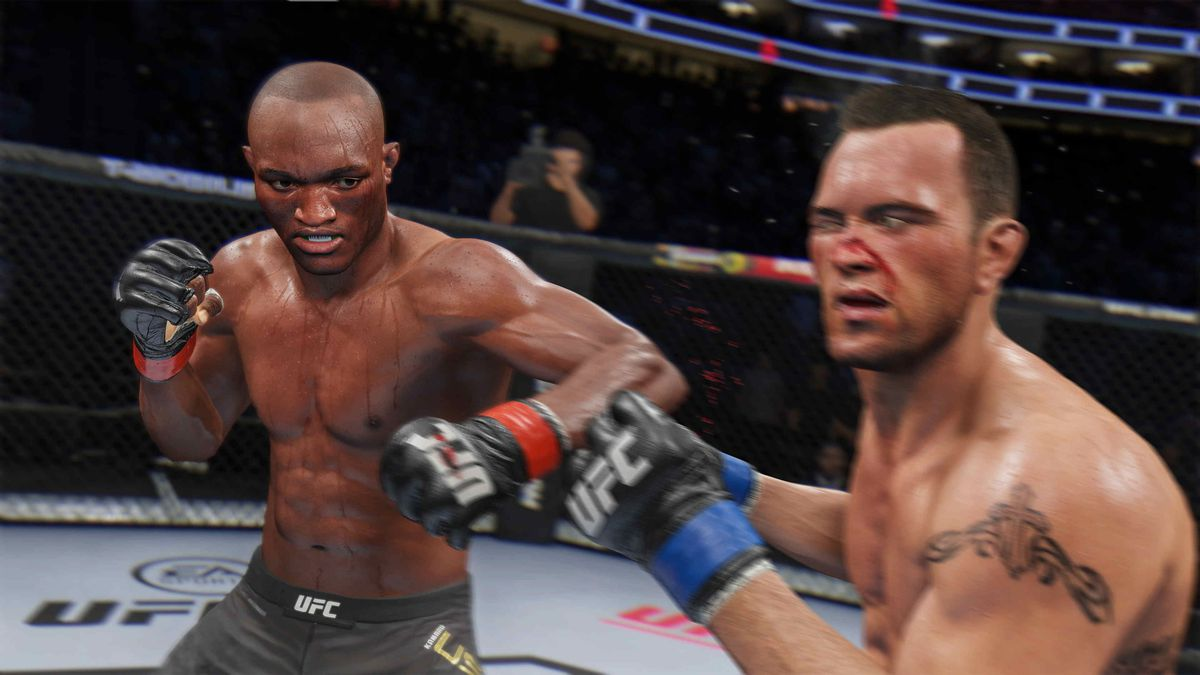 One fighter lands a left hook to the jaw of another, knocked cross-eyed by the impact.