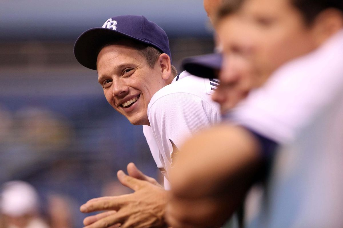 June 28, 2012; St. Petersburg, FL, USA; Tampa Bay Rays pitcher Jeremy Hellickson (58) smiles in the dugout against the Detroit Tigers at Tropicana Field. Detroit Tigers defeated the Tampa Bay Rays 5-2. Mandatory Credit: Kim Klement-US PRESSWIRE