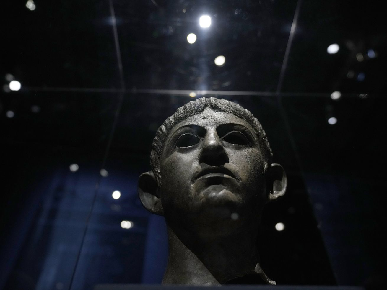 """A bronze head of Roman emperor Nero dating from around AD 54-61 and found in the River Alde at Rendham in Suffolk, eastern England, is displayed in """"Nero: The Man Behind the Myth"""" exhibition at the British Museum in London."""