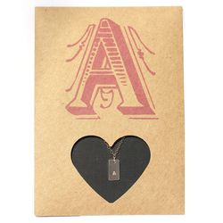 """The initial card and stamped necklace by The Urban Smith, <a href=""""http://www.theurbansmith.com/cards-html/cardletters.html"""">$50</a>"""