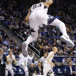 Brigham Young Cougars forward Yoeli Childs (23) slams over Portland Pilots in Provo on Thursday, Dec. 28, 2017. BYU won 69-45.