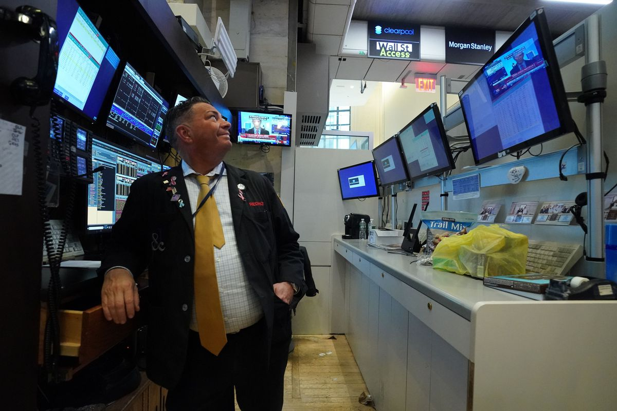 Traders work on the floor of the New York Stock Exchange on March 11, 2020 in New York.