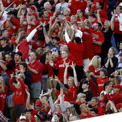Utah fans celebrate a touchdown as BYU and Utah play Saturday, Sept. 17, 2011
