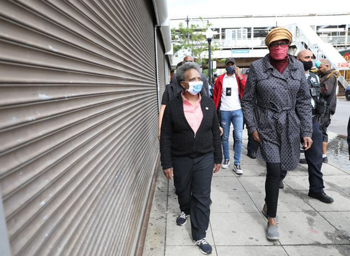 Mayor Lori Lightfoot and Ald. Pat Dowell (3rd) checked out the looting damage in Bronzeville on Monday.
