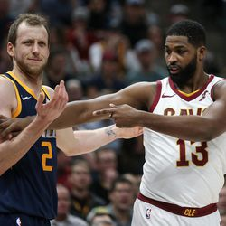 Cleveland Cavaliers center Tristan Thompson (13) motions to a referee as Utah Jazz forward Joe Ingles (2) throws up his arms at Vivint Arena in Salt Lake City on Saturday, Dec. 30, 2017.