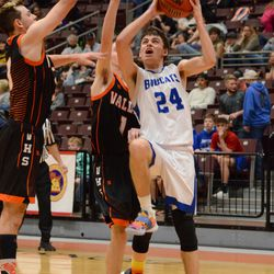 Panguitch's Paxton Wolfley battles his way to the hope Friday night in Richfield.