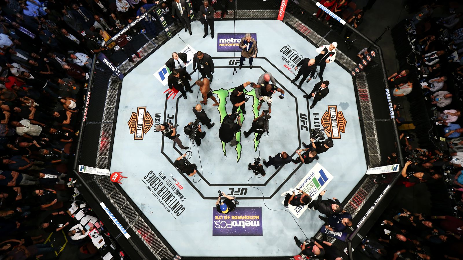 Midnight Mania! DC Allowed To Stumble Around Cage After KO Loss
