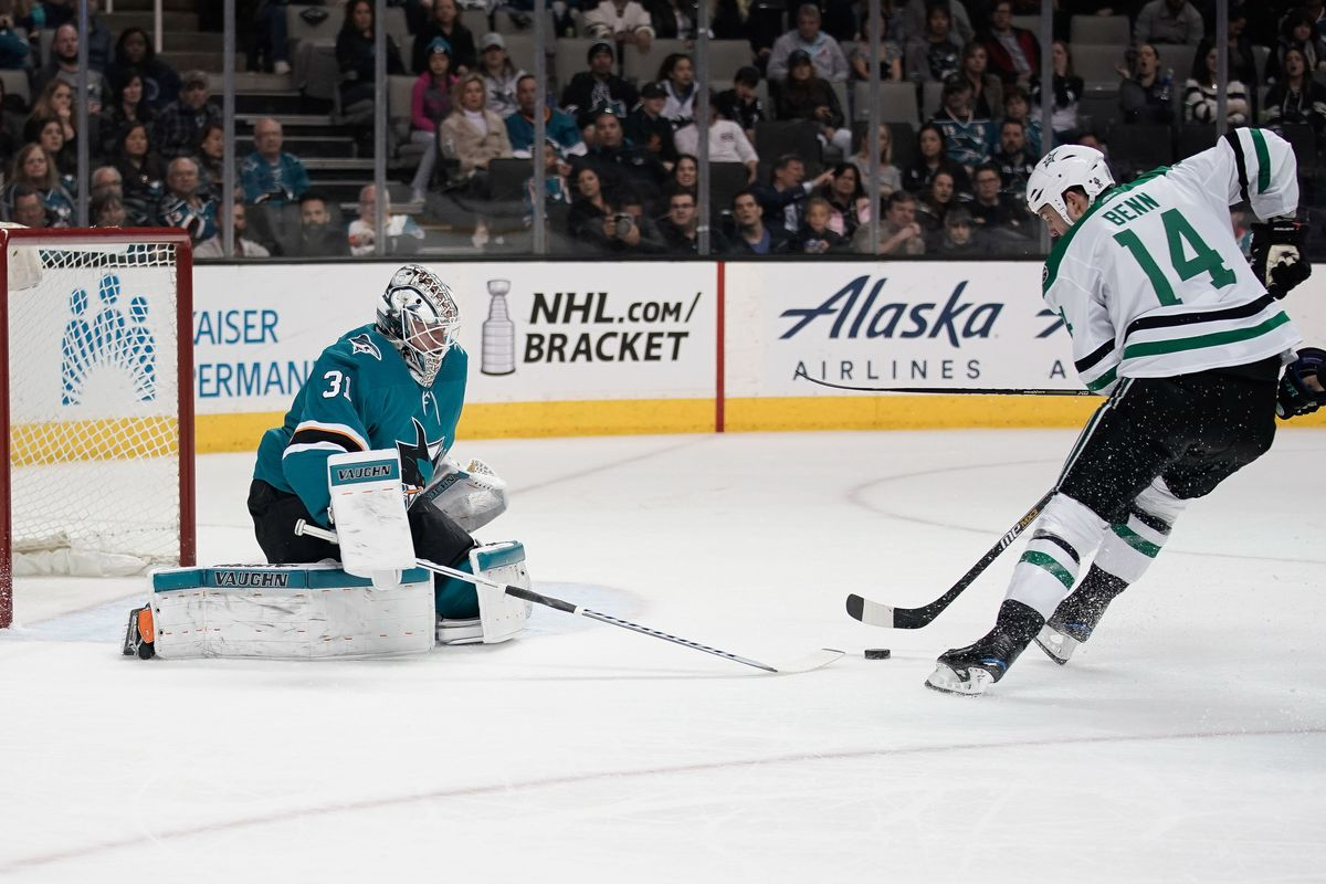 Apr 3, 2018; San Jose, CA, USA; San Jose Sharks goaltender Martin Jones (31) attempts to defend against Dallas Stars left wing Jamie Benn (14) during the third period at SAP Center at San Jose.