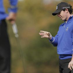 Europe's Rory McIlroy looks over a putt on the first hole during a practice round at the Ryder Cup PGA golf tournament Wednesday, Sept. 26, 2012, at the Medinah Country Club in Medinah, Ill.