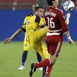 Real Salt Lake midfielder Luis Gil, left, reaches high to kick a ball away from FC Dallas defender Bobby Warshaw (16) in the first half of a U.S. Open Cup quarterfinal soccer match Tuesday, July 12, 2011, in Frisco, Texas.