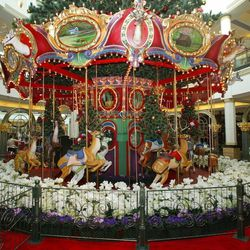 Over in the Plaza's Nordstrom Court, a holiday carousel displays scenes from Valley Forge National Historic Park and Longwood Gardens.