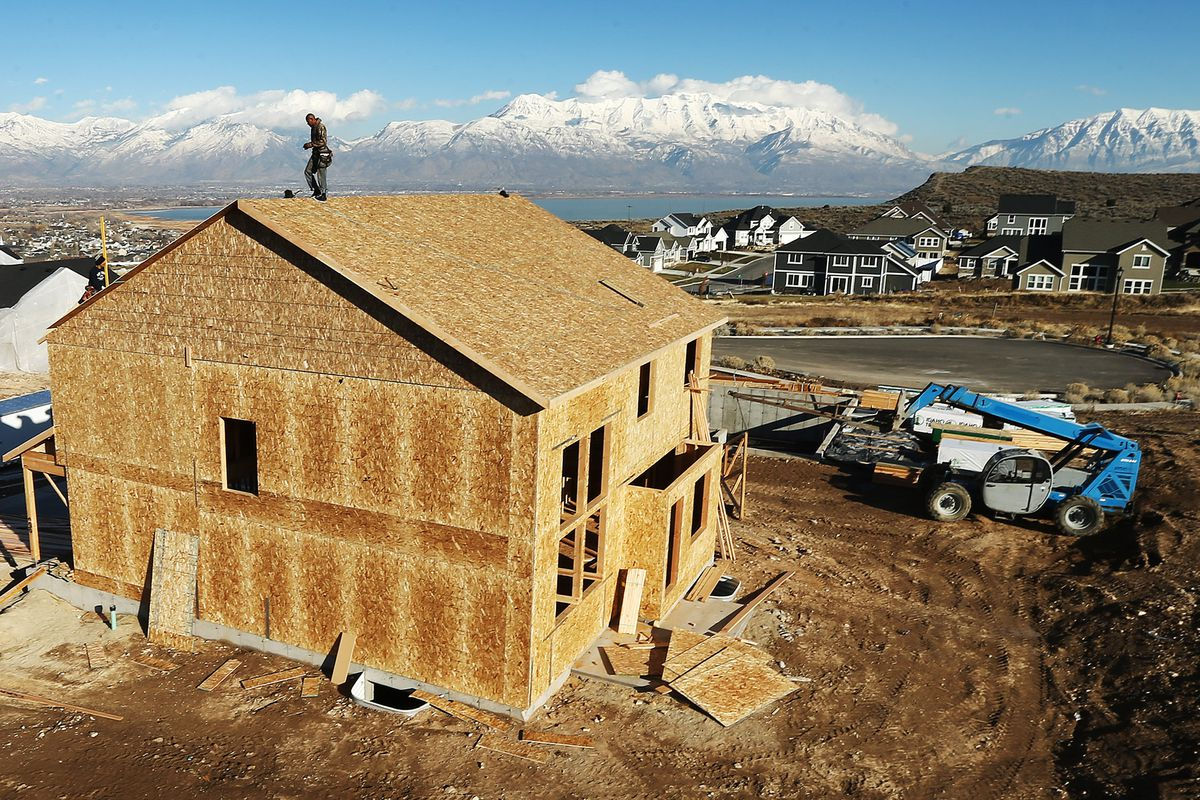 Framers work on a new home in Saratoga Springs on Monday, Dec. 12, 2016. For the third year in a row, Utah County surpassed Salt Lake County in population growth, making it the new epicenter of population growth in the Beehive State.