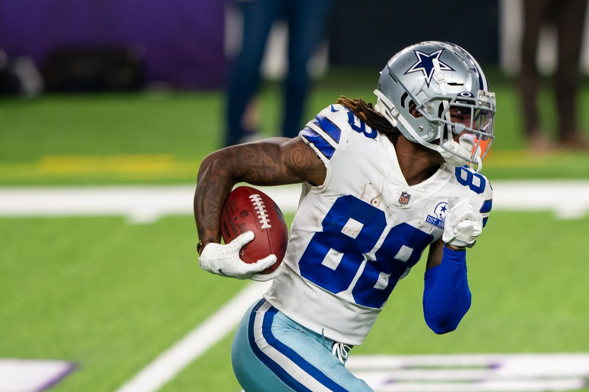 Dallas Cowboys wide receiver CeeDee Lamb (88) runs with the ball in the fourth quarter against the Minnesota Vikings at U.S. Bank Stadium.