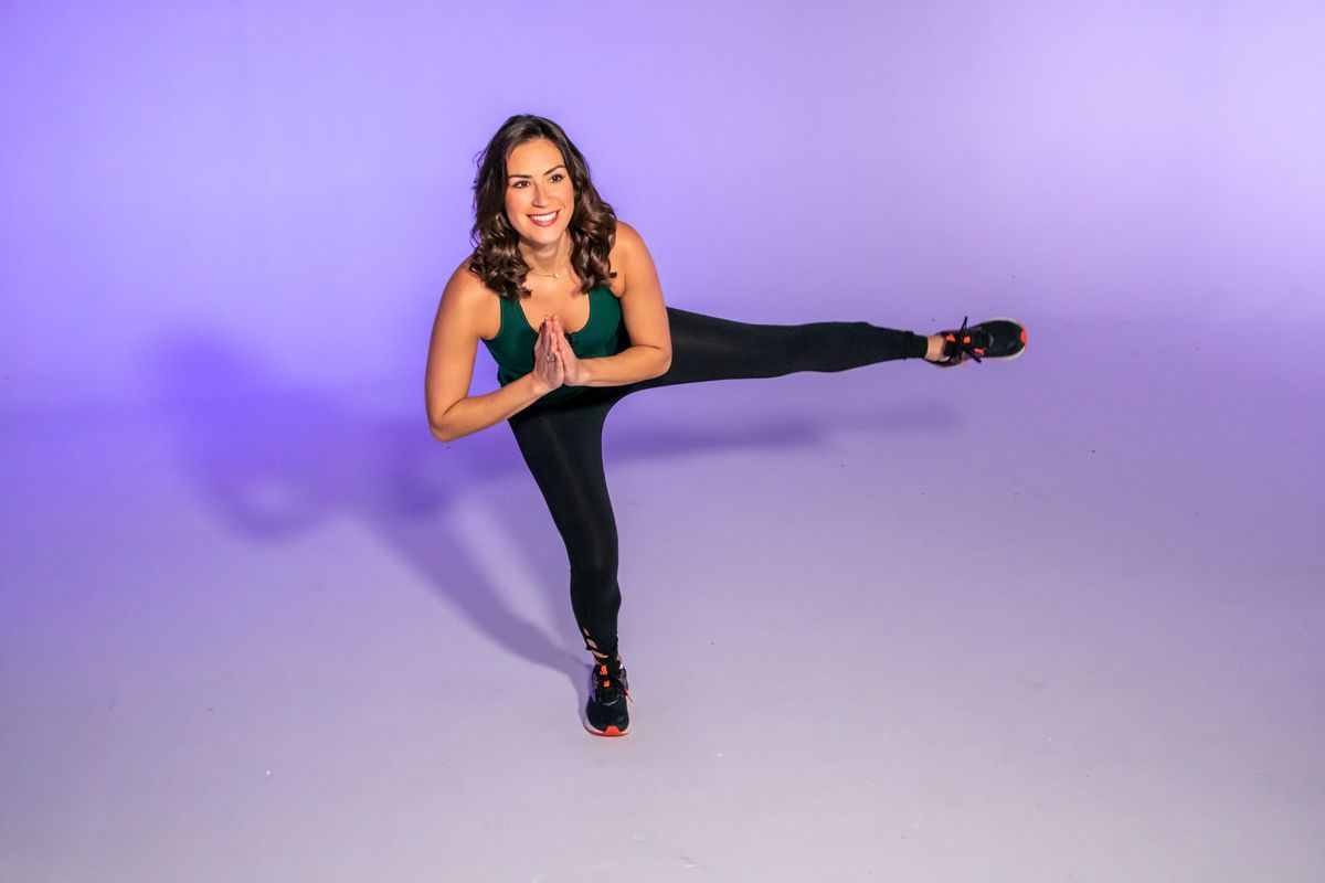 """Health and fitness expert Stephanie Mansour demonstrates a leg lift in side lunge which is part of her """"trifecta"""" workout for a well-rounded bottom."""