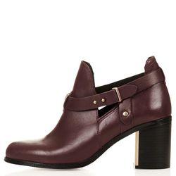 "Topshop 'Martha' cut-out booties, <a href=""http://us.topshop.com/en/tsus/product/shoes-70484/boots-70514/martha-cut-out-boots-3118118?bi=1&ps=200"">$130</a>"