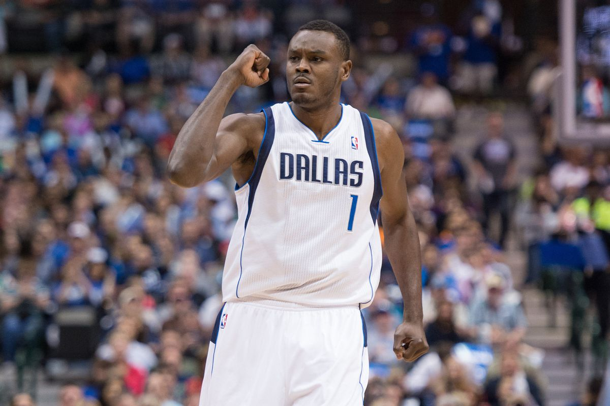 Dalembert celebrates after hitting a jump shot to open the game, and then looks to the bench.