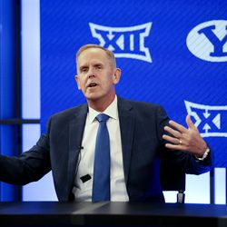 """BYU athletic director Tom Holmoe gestures while stating, """"I love the fact that we get to go into the Big 12 with all our teams"""" during a press conference announcing that BYU has accepted an invitation to the Big 12 Conference at BYU in Provo on Friday, Sept. 10, 2021. BYU will play all sports provided by the Big 12 except for equestrian, rowing and wrestling. Men's volleyball will continue to play in the Mountain Pacific Sports Federation, as the Big 12 does not offer the sport."""