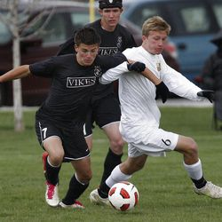 Viewmont's Lucas Cawley (left) and Davis' Derek Farnes fight for position as Davis High School plays Viewmont High School in boy's soccer Friday, April 29, 2011, in Kaysville, Utah.  (Tom Smart, Deseret News)