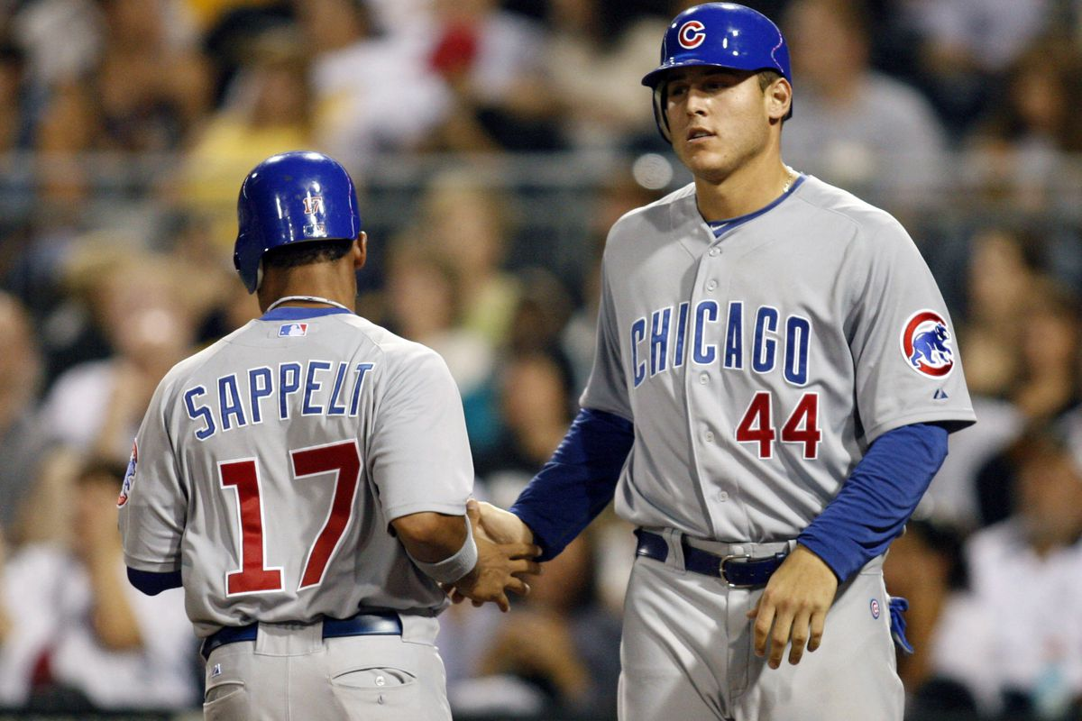 Pittsburgh, PA, USA; Chicago Cubs pinch runner Dave Sappelt and first baseman Anthony Rizzo celebrate at home plate after both men scored against the Pittsburgh Pirates at PNC Park. Credit: Charles LeClaire-US PRESSWIRE