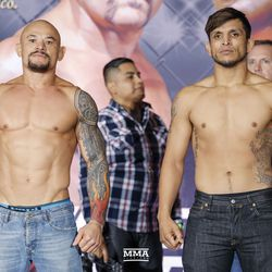 Gleison Tibau and Efrain Escudero face the crowd at the Liddell vs. Ortiz 3 ceremonial weigh-ins in Inglewood, Calif.